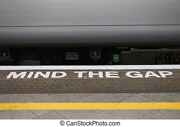 Mind the gap alert. Train station in England.