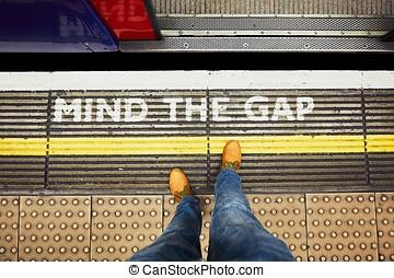 Mind the gap - Man is waiting in underground station -...