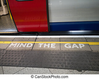Mind The Gap Sign: Underground in Central London