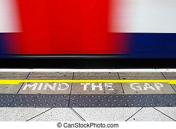 Mind the gap, warning in the London underground...
