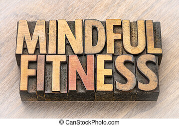 mindful fitness word abstract in wood type
