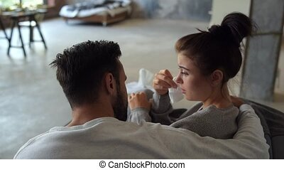 Mindful husband cheering up sick wife