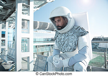 Mindful male astronaut in wait - Boring spending time....
