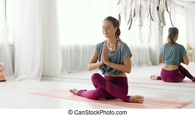 woman meditating at yoga studio - mindfulness, spirituality...