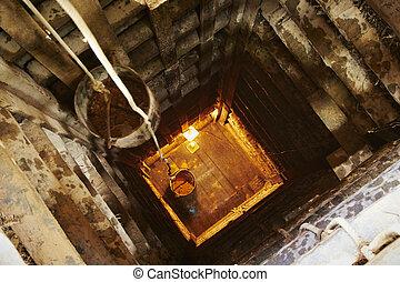 Looking down into the moonstone mine in Sri Lanka.