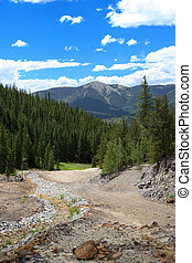 Mine Tailings - Small streambed runs alongside a talus slope...