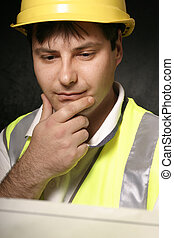 Miner reading a map - This could be a miner or tradesmen or...