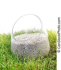 Mineral fertilizer on grass