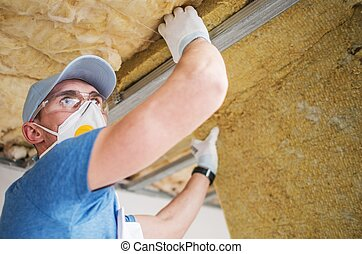 Mineral Insulation Installer. Caucasian Construction Worker...