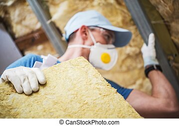 Mineral Rock Wool Insulating Concept Photo. Worker with...