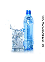 Mineral Water - Glass of splashing water and plastic bottle...