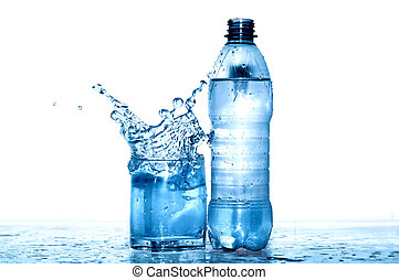 Mineral Water - Glass of splashing water near plastic...
