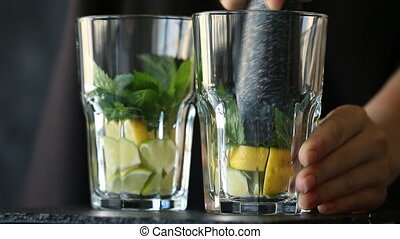 Mineral water in the glass with ice cubes, mint, lime and ...