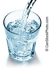 mineral water - water jet filling a glass on white...