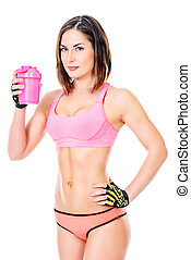 mineral water - Sporty young woman drinking water after...
