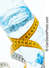 Mineral water with measuring tape. Symbol diet.