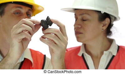 Miners Inspecting Carbon Graphite O - Short depth of field...