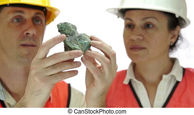 Miners Inspecting Copper Carbonate - Short depth of field...