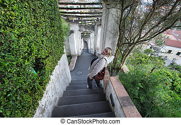 Minerva Gardens Salerno - Woman on the staircase of Minerva...