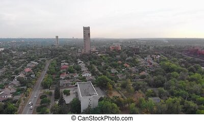 Mines in the city red iron ore aerial drone forward push in camera movement Krivoy Rog Ukraine