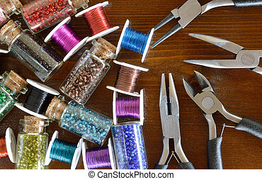 Mini bottles with beads, wire crafts and pliers