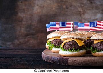 Mini burgers - Mini beef burgers with American flag on...
