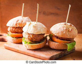 mini burgers with tomato, lettuce and meat cutlet