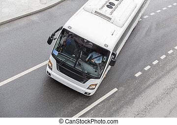 Mini bus changes from lane to lane.