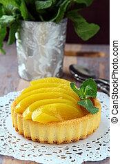 mini cake with cream and peach