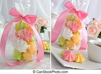 """Mini cakes """"meringue"""" of different colors on a saucer with a cup of coffee and packaging"""