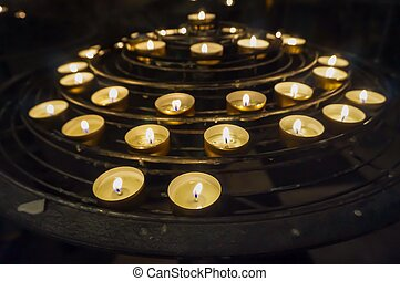 Mini candles on a metal stand
