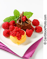 Mini chocolate cake with fresh raspberries and ice cream