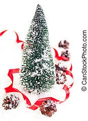 Mini Christmas tree with pinecone on snow