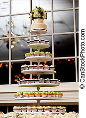 Mini cupcakes - mini cupcakes on a multi level tier in...
