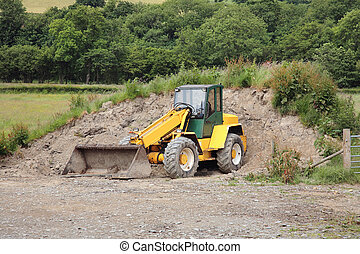 Mini Digger Man In A Mini Digger Digging A Trench In A Field