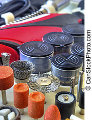 Mini drill machine with set of different grinding and cutting accessories