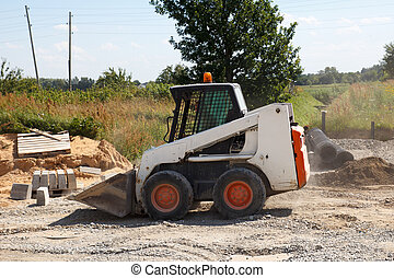 mini excavator bobcat working in construction site, making...