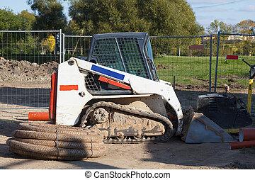 Mini exceavator at construction site