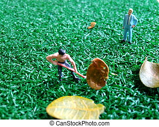 mini figure toy working gardener, controlled by his boss