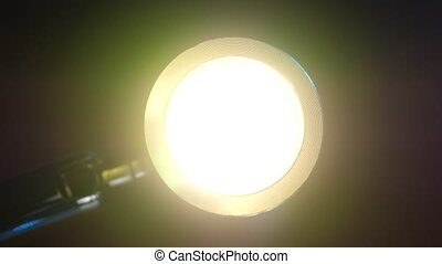 Close up of a mini flashlight in operation