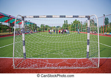 Mini Football Goal On An Artificial Grass . Football defocused players penalty on field Small, Futsal ball field in the gym indoor, Soccer sport field . Corner of a soccer field