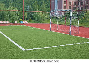 Mini Football Goal On An Artificial Grass . football goal on a green lawn