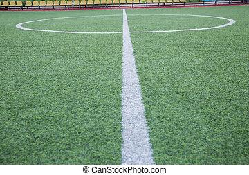 Mini Football Goal On An Artificial Grass . Inside of indoor football field . Mini football stadium center .soccer field center and ball top view background