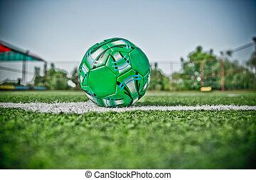 Mini Football Goal On An Artificial Grass . Inside of indoor football field . Mini soccer ball . HDR photo