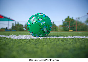 Mini Football Goal On An Artificial Grass . Inside of indoor football field . Mini soccer ball