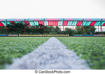 Mini Football Goal On An Artificial Grass . Inside of indoor football field . soccer field center and ball top view background