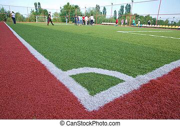 Mini Football Goal On An Artificial Grass . soccer corner kick .