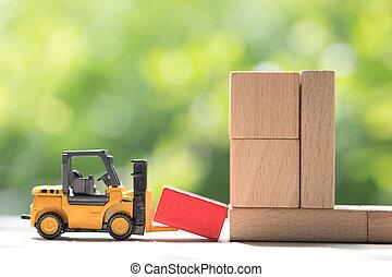 Mini forklift truck load red wooden block