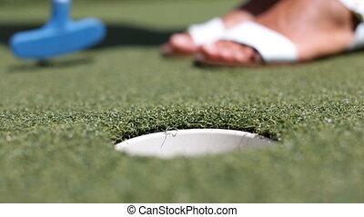 Mini golf, miniature golf or Mini Putt - woman putting with ...