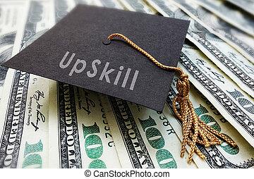 Mini graduation cap with Upskill text on money